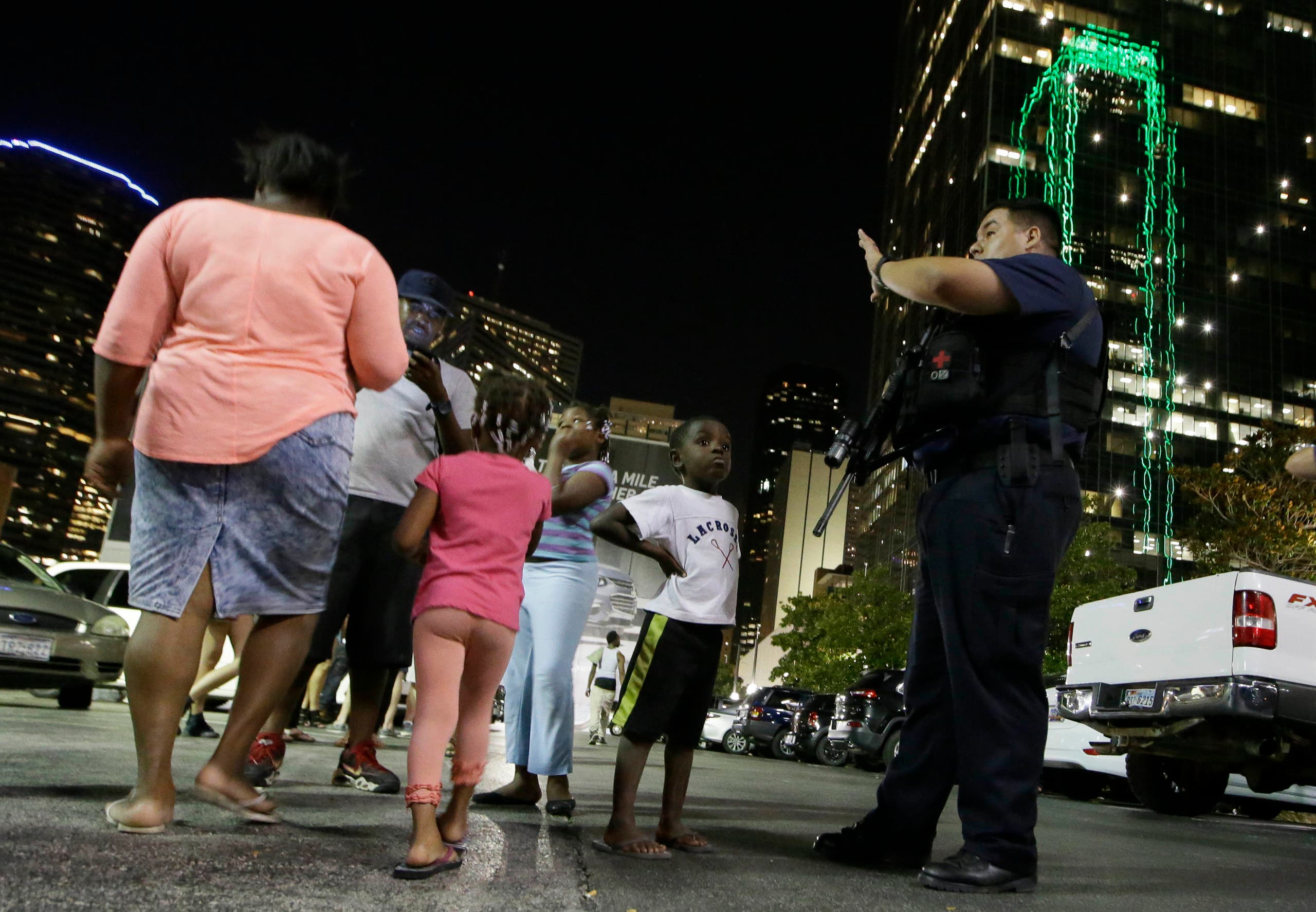 Dallas police order people away from the area after several police were shot in downtown Dallas, Thursday, July 7, 2016. (AP)