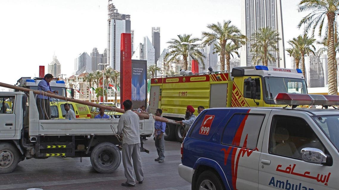 "Rescue crews are seen outside the Dubai Mall in Dubai, United Arab Emirates, Thursday Feb. 25, 2010. A large section of the Middle East's biggest shopping mall has been closed as maintenance crews scramble to contain a leak at the massive, shark-filled aquarium there. An official at Dubai's civil defense department said ""there has been a small break in the glass"". (AP Photo/Farhad Berahman)"