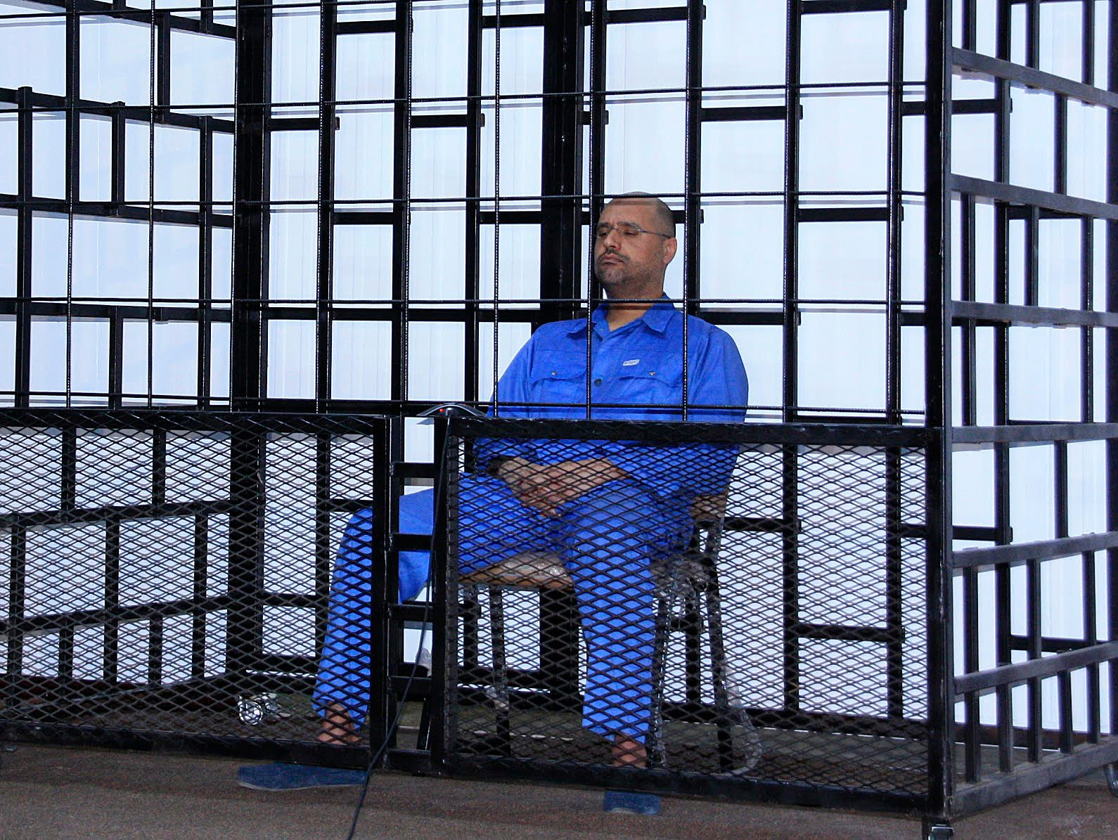 Saif al-Islam Qaddafi, son of late Libyan leader Muammar Gaddafi, attends a hearing behind bars in a courtroom in Zintan May 25, 2014. (Reuters)