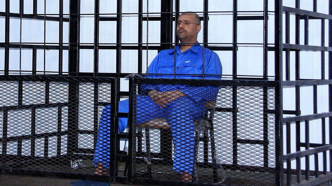 Saif al-Islam Qaddafi, son of late Libyan leader Muammar Gaddafi, attends a hearing behind bars in a courtroom in Zintan May 25, 2014. (Reuters)
