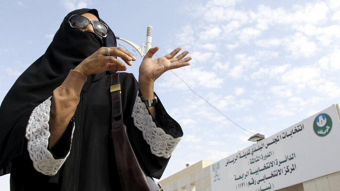 A woman gestures as she leaves a polling station after casting her vote during municipal elections, in Riyadh, Saudi Arabia December 12, 2015. (Reuters)
