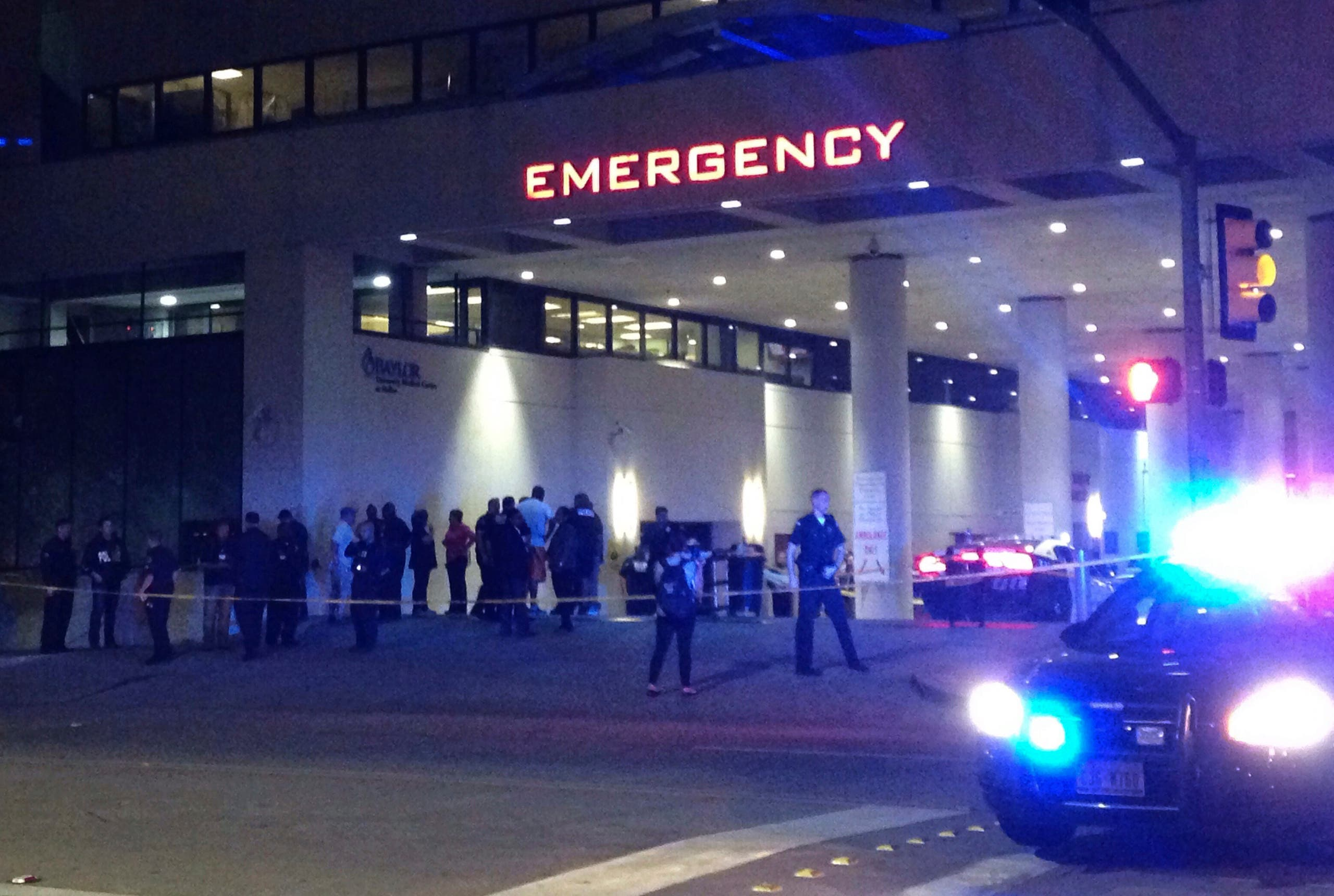 Police and others gather at the emergency entrance to Baylor Medical Center in Dallas, where several police officers were taken after shootings Thursday, July 7, 2016. (AP)