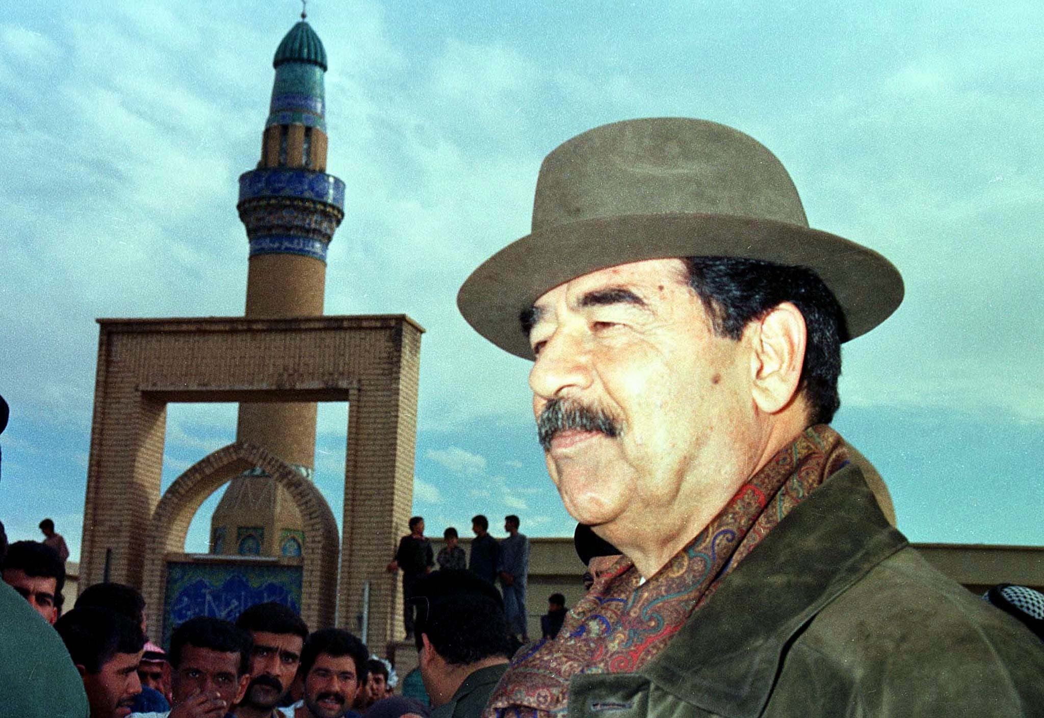 Iraqi President Saddam Hussein greets people of the village of al-Budoor, 180 km (110 miles) from Baghdad, March 29. Saddam regaled villagers with daring tales from his youth while U.N. weapons inspectors scoured his hometown palace. (Reuters)