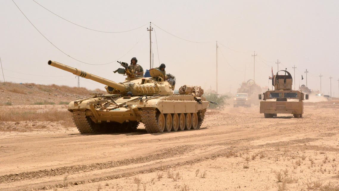 Iraqi government forces drive a tank on June 22, 2016 some 40 kilometers west of Qayyarah, during their operation to take the city and make it a launchpad for Mosul. (AFP)