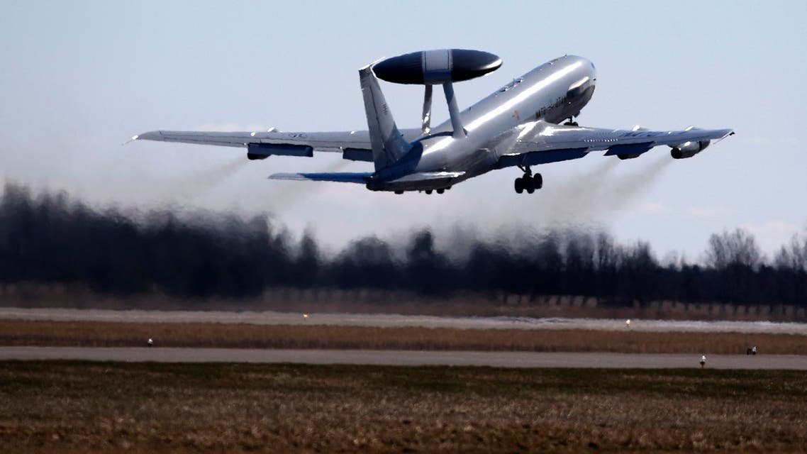 NATO Airborne Warning and Control System (AWACS) aircraft take off near Vilnius, Lithuania, Tuesday, April 1, 2014.  (AP)