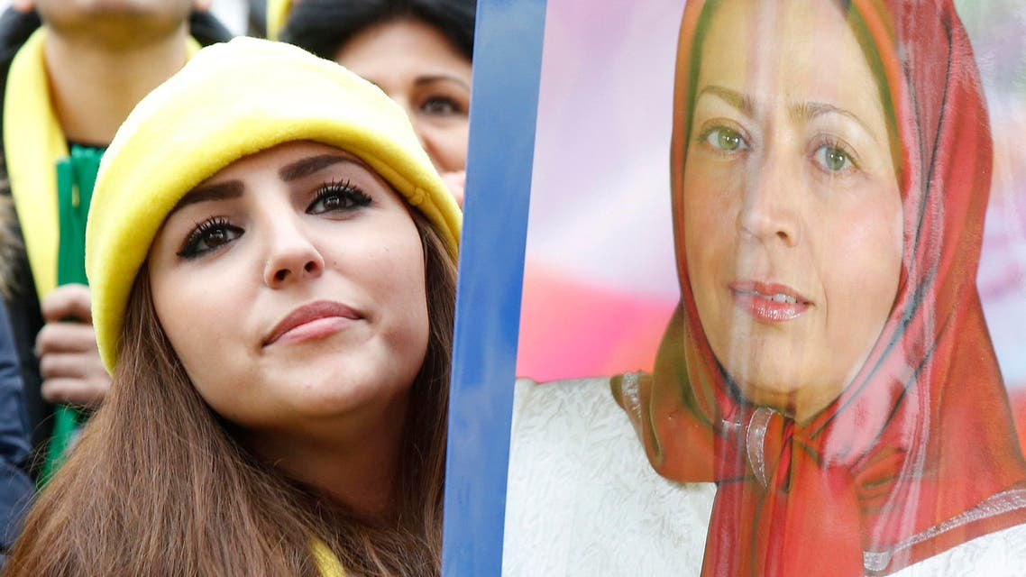 A demonstrator holds a placard showing a portrait of Maryam Rajavi, President of the National Council of Resistance of Iran (NCRI), during a protest against Iran's President Hassan Rouhani visit to France in central Paris, France, January 28, 2016