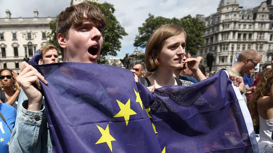 People hold flags during a 'March for Europe' demonstration against Britain's decision to leave the European Union, in central London, Britain July 2, 2016. (Reuters)