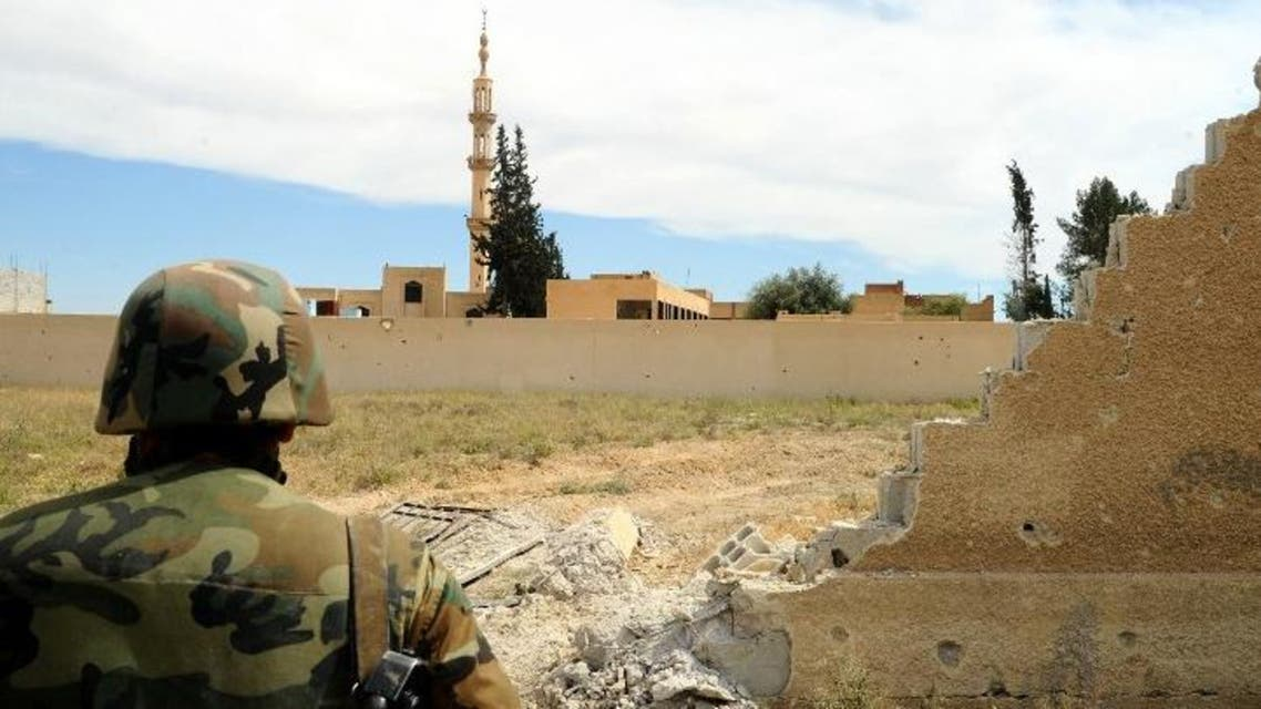 A handout picture released by the Syrian Arab News Agency (SANA) on May 3, 2015 shows a Syrian pro-government fighter keeping position in the village of Maydaa in rural Damascus. (AFP)