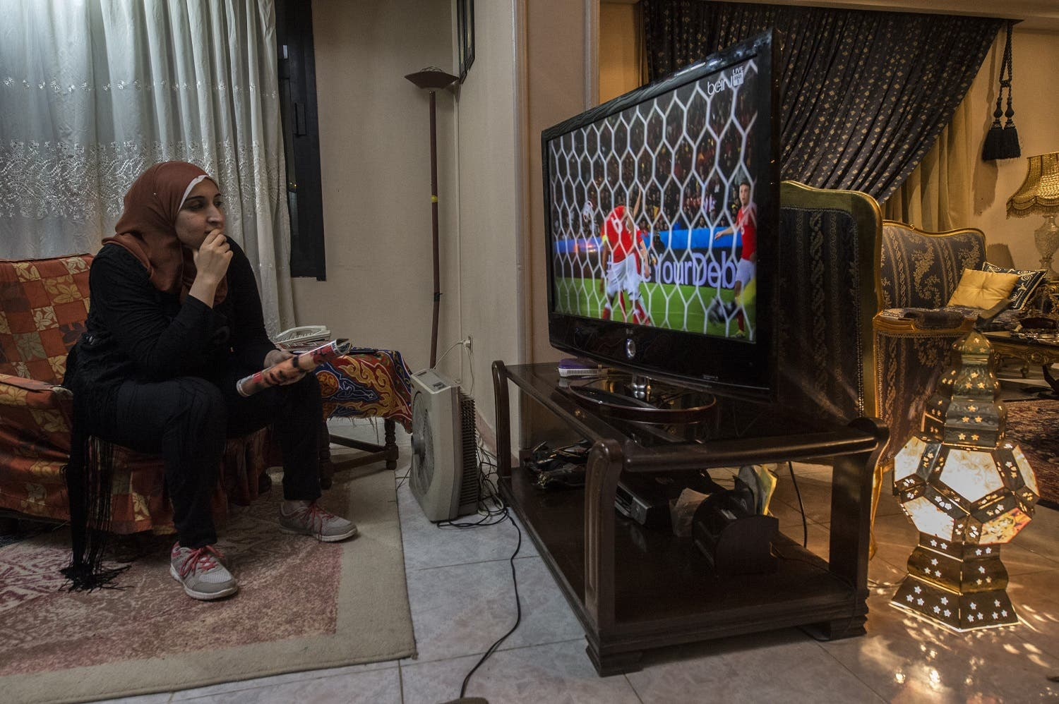 Football analyst Manar Sarhan watches the Euro 2016 quarter-final between Wales and Belgium at her home in the Egyptian capital Cairo. (AFP)