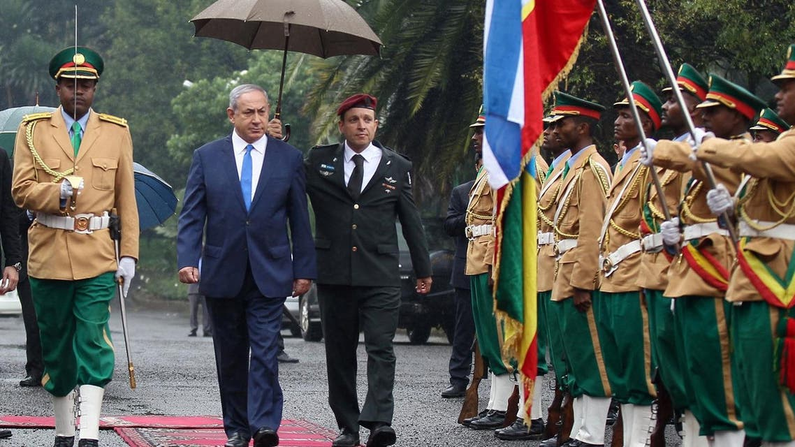 Israeli Prime Minister Benjamin Netanyahu inspects a guard of honor at the National Palace during his State visit to Addis Ababa, Ethiopia, July 7, 2016. REUTERS