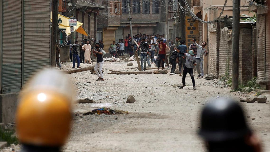 Protesters throw stones towards Indian police during a protest against the killing of Burhan Wani, a separatist militant leader, in Srinagar, July 10, 2016. REUTERS/Danish Ismail
