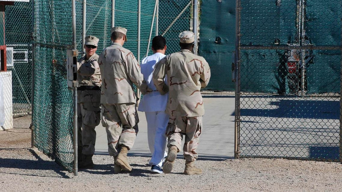 """US Navy guards escort a detainee through Camp Delta at Guantanamo Bay naval base in a June 10, 2008 file photo provided by the US Department of Defense. President Barack Obama urged lawmakers on Tuesday to give his plan to close the U.S. military prison at Guantanamo Bay, Cuba, a """"fair hearing"""" and said he did not want to pass the issue to his successor when he leaves the White House next year. REUTERS"""