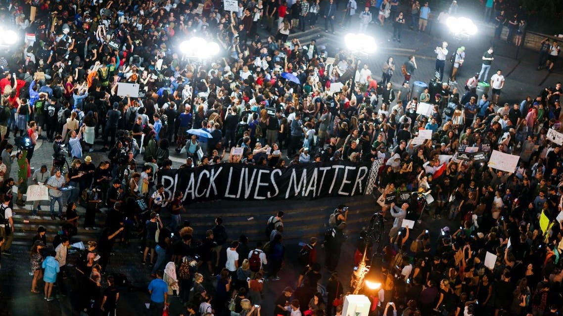 People take part in a protest against police brutality and in support of Black Lives Matter during a march in New York July 9, 2016. REUTERS