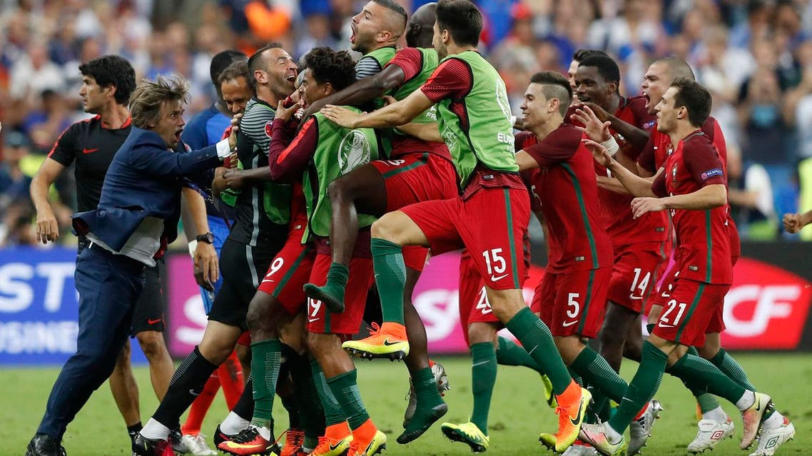 Portugal's Eder celebrates with team mates after scoring their first goal (Reuters)