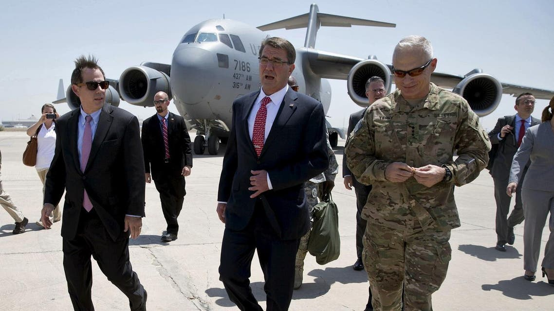 U.S. Defense Secretary Ash Carter (C) is greeted by U.S. Ambassador to Iraq Stuart Jones (L) and Army Lt. Gen. James Terry (R) as he arrives at Baghdad International Airport in Baghdad, Iraq, July 23, 2015. Carter made a surprise visit to Baghdad on Thursday to get a first-hand assessment of the campaign against Islamic State as Iraq tries to retake the fallen capital of Sunni-dominated Anbar province. REUTERS