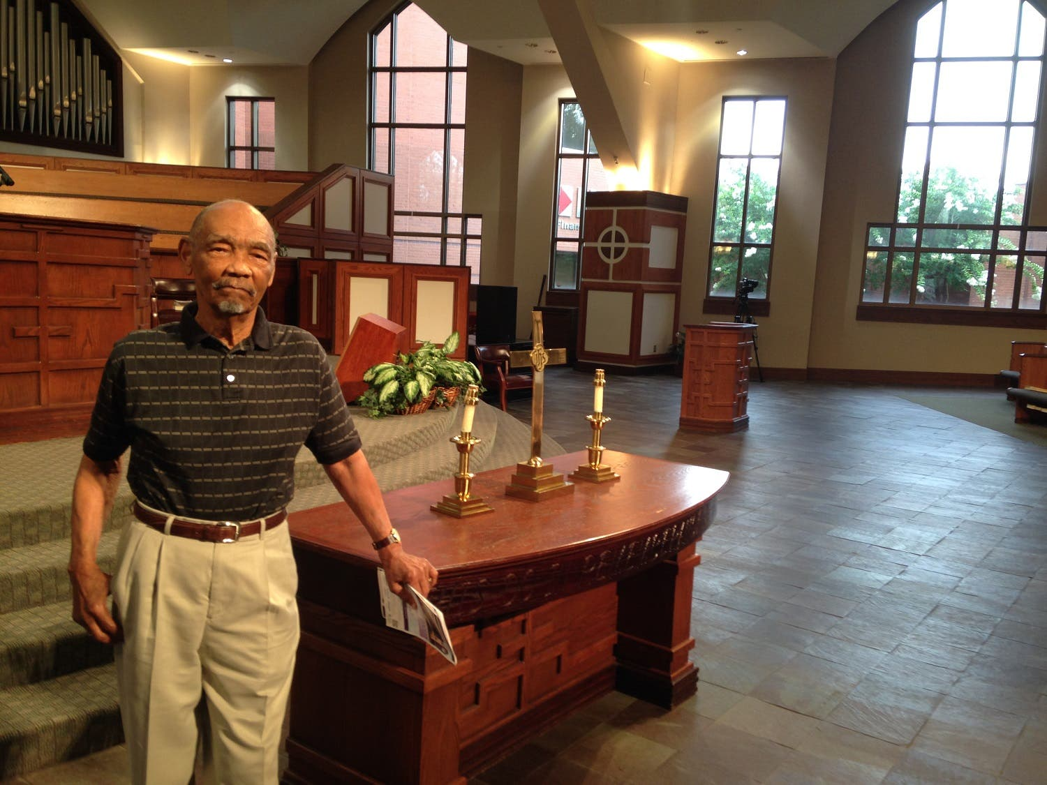 """Howard King, 91, stands inside Ebenezer Baptist Church, Sunday, July 10, 2016, in Atlanta. King has been a member of Ebenezer Baptist Church since the height of the civil rights movement, when he got to know then-pastor Martin Luther King Jr. King says he understands the frustrations of young black activists in the wake of two more killings of black men by police, and he says anyone who """"calls themselves Christian"""" should speak out about institutional racism that remains entrenched decades after the civil rights movement. Yet King also condemns the killing of five Dallas police officers by a lone gunman seeking retaliation for the killings of Alton Sterling in Louisiana and Philando Castile in Minnesota. """"There is no justification for taking life _ black, white, green or yellow,"""" he says. (AP)"""