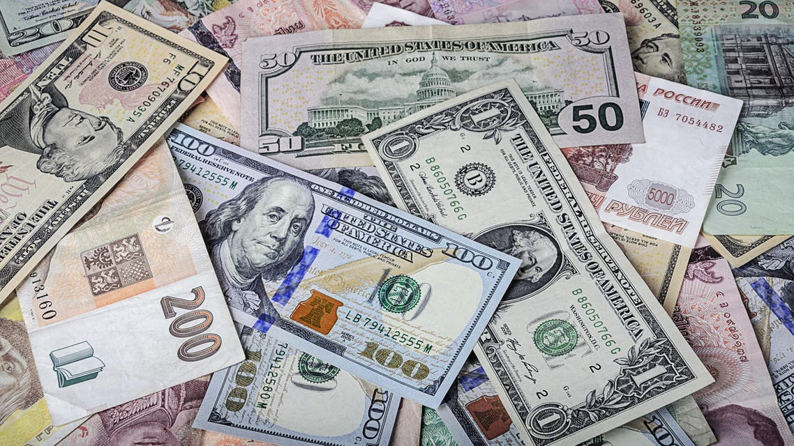 International currencies scrambled randomly ontop of each other.  (Shutterstock)