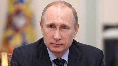 بوتين يطلب من ميركل وهولاند تفادي التصعيد بأوكرانيا