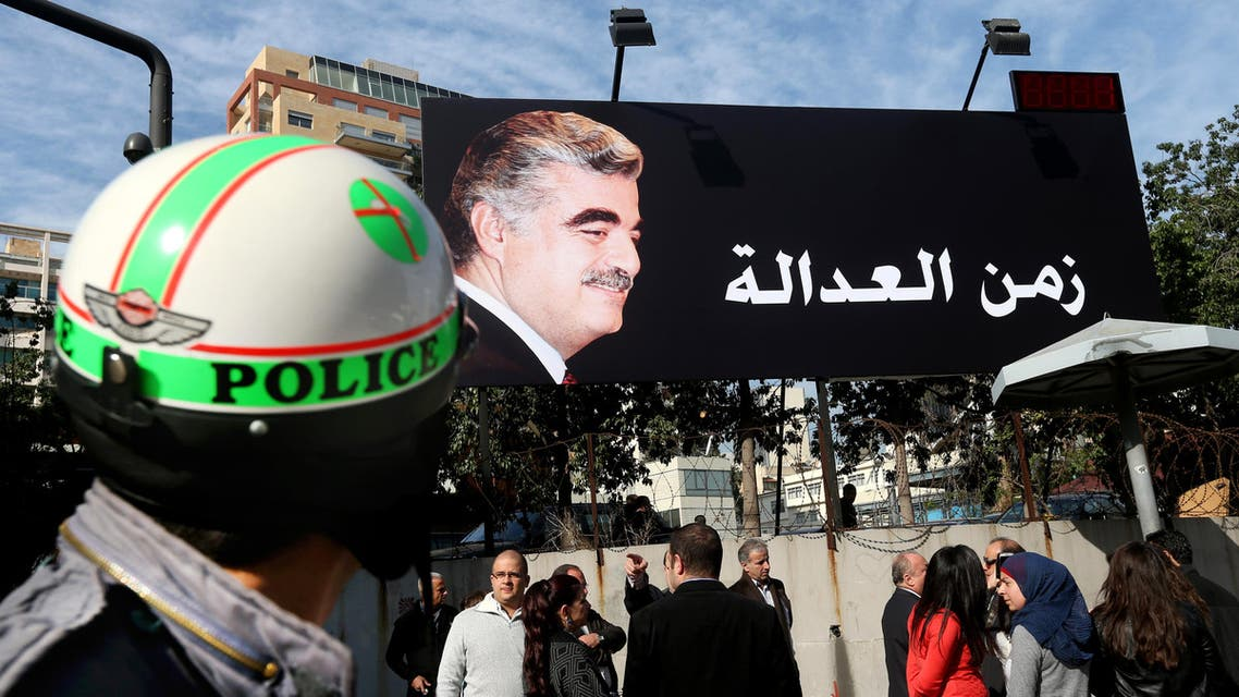 "Supporters of slain former Lebanese Prime Minister Rafik Hariri, gather under a giant billboard with his portrait and Arabic that reads, ""Justice,"" in Beirut, Lebanon, Thursday, Jan. 16, 2014. (AP)"