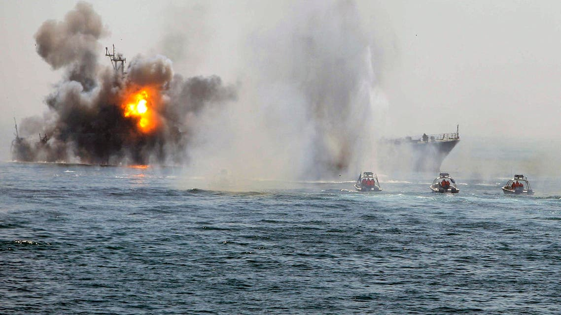 An Iranian warship and speed boats take part in a naval war game in the Persian Gulf and the Strait of Hormuz, southern Iran April 22, 2010. (Reuters)