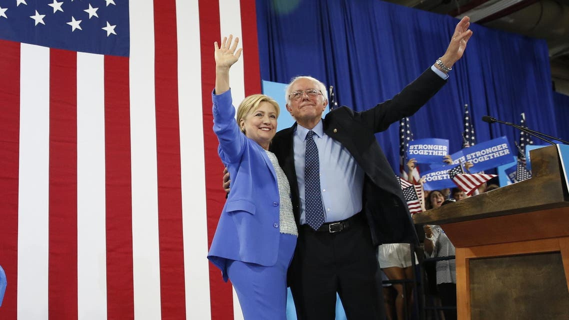 Democratic presidential candidate Hillary Clinton and Sen. Bernie Sanders, I-Vt. wave during a rally in Portsmouth, N.H., Tuesday, July 12, 2016. (AP)