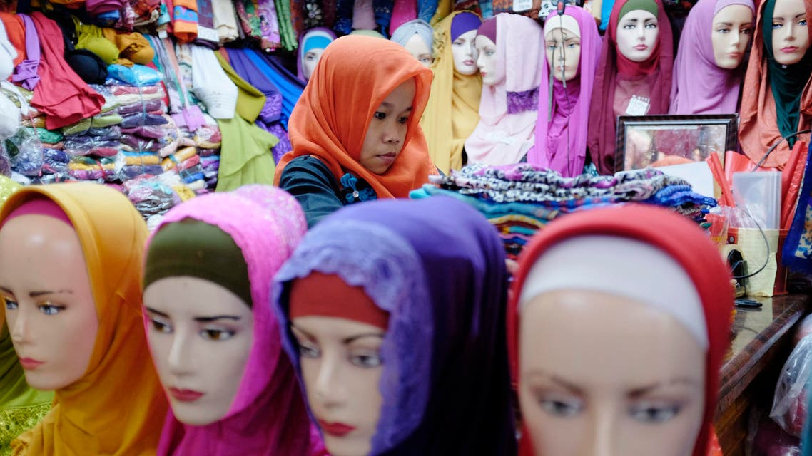 A vendor prepares Muslim head scarves at a stall in Tanah Abang market in Jakarta February 5, 2015.