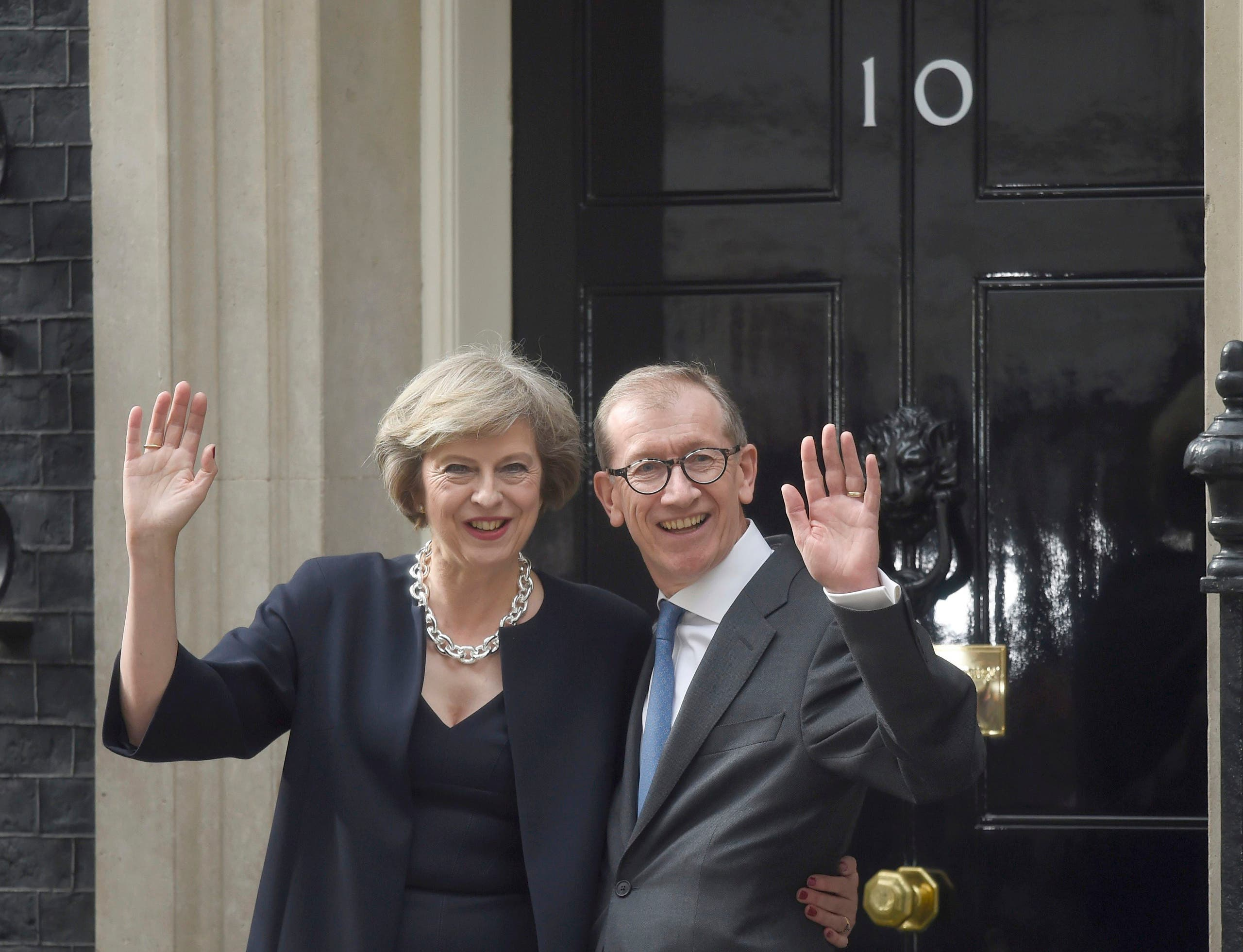 Britain's Prime Minister, Theresa May, and husband Philip pose for the media outside number 10 Downing Street, in central London, Britain July 13, 2016. (Reuters)
