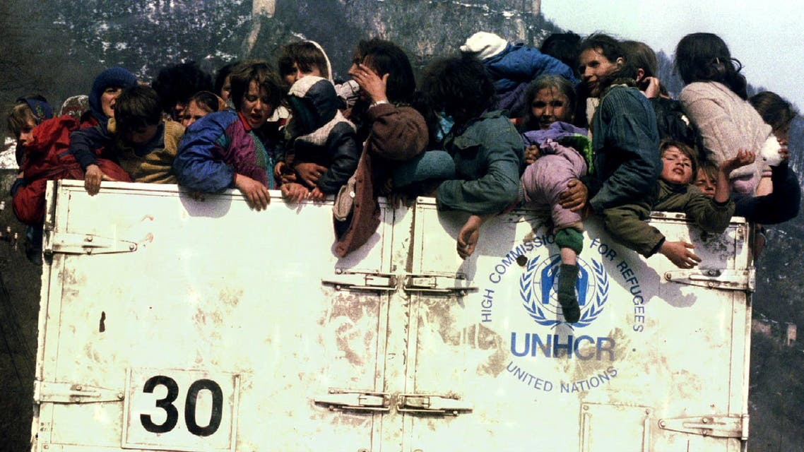 Muslims refugees in an overloaded UNHCR truck March 31, 1993 during evacuation from besieged Srebrenica as part of agreement between Serbs. On July 11, 1995. (Reuters)