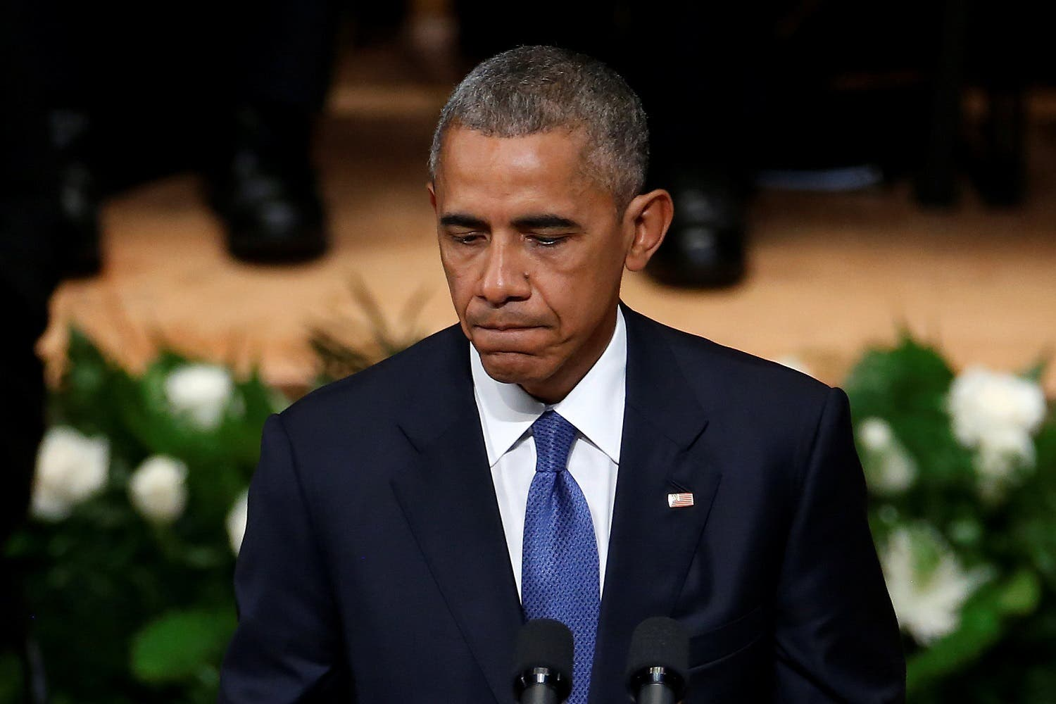 Obama made a poignant appeal for fellow Americans to rise to the occasion and transform shock and grief into a determination to act. (Reuters)