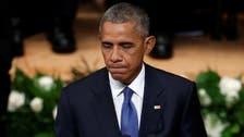 Obama tells Dallas memorial US 'not as divided as we seem'