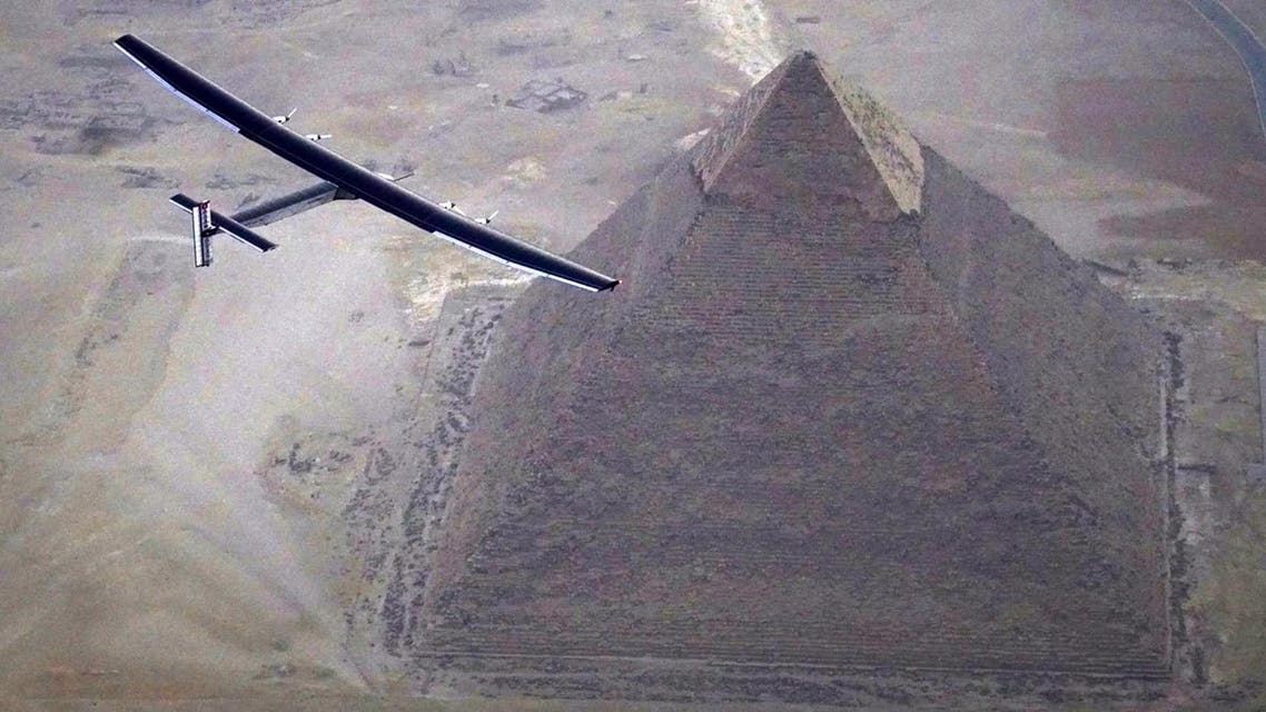 The solar powered plane, piloted by Swiss pioneer André Borschberg, is seen during the flyover of the pyramids of Giza. (AFP)