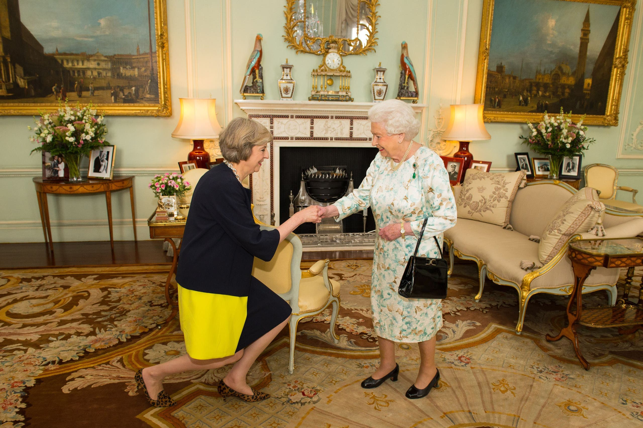 [Window Title] Save As  [Content] Queen Elizabeth II welcomes Theresa May, left, at the start of an audience in Buckingham Palace, London, where she invited the former Home Secretary to become Prime Minister and form a new government, Wednesday July 13, 2016. (AP) The file name is not valid.  [OK]