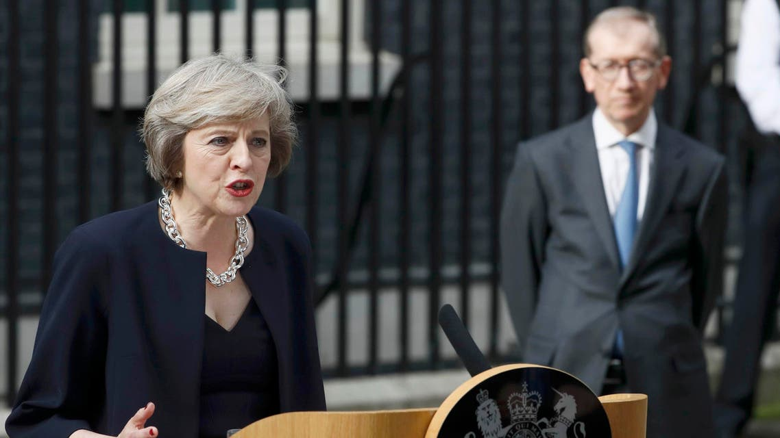 Britain's Prime Minister, Theresa May, watched by husband Philip, speaks to the media outside number 10 Downing Street, in central London, Britain July 13, 2016.  (Reuters)