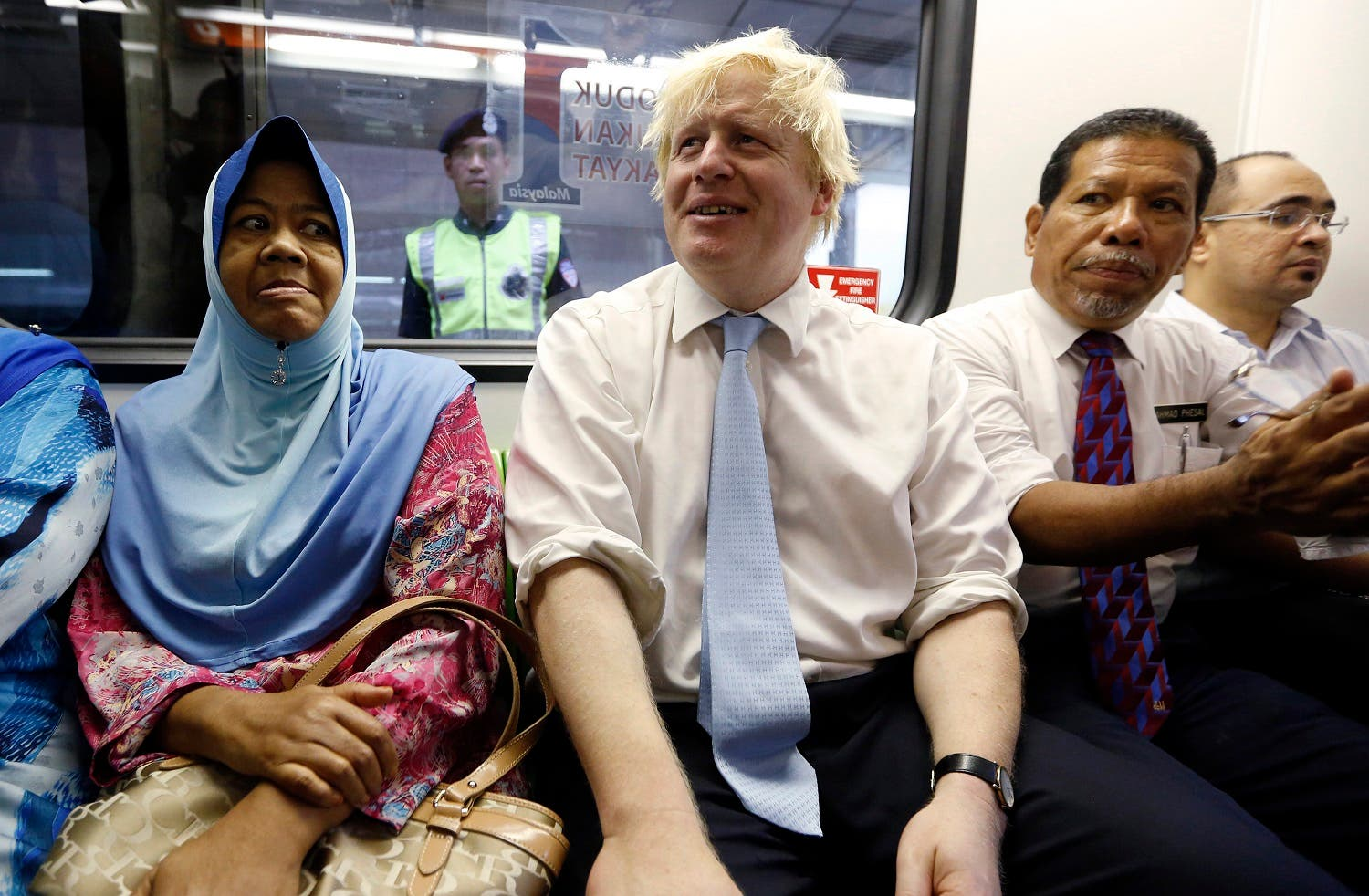 London's Mayor Boris Johnson rides on the monorail during an official visit to Kuala Lumpur. (File photo: Reuters)