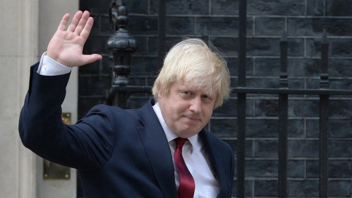 Newly appointed Foreign Secretary Boris Johnson waves as he leaves 10 Downing Street in central London on July 13, 2016 after new British Prime Minister Theresa May took office. (AFP)