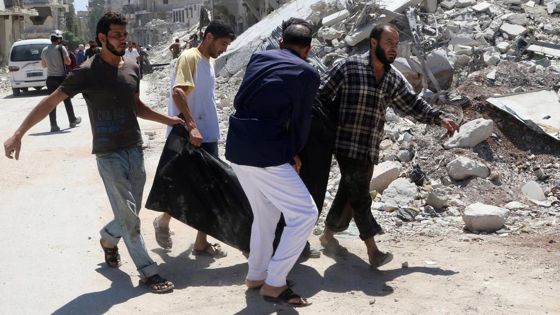 Men carry a dead body near a damaged building after an airstrike on the rebel held Al-Hilwaniyeh neighbourhood in Aleppo. (Reuters)