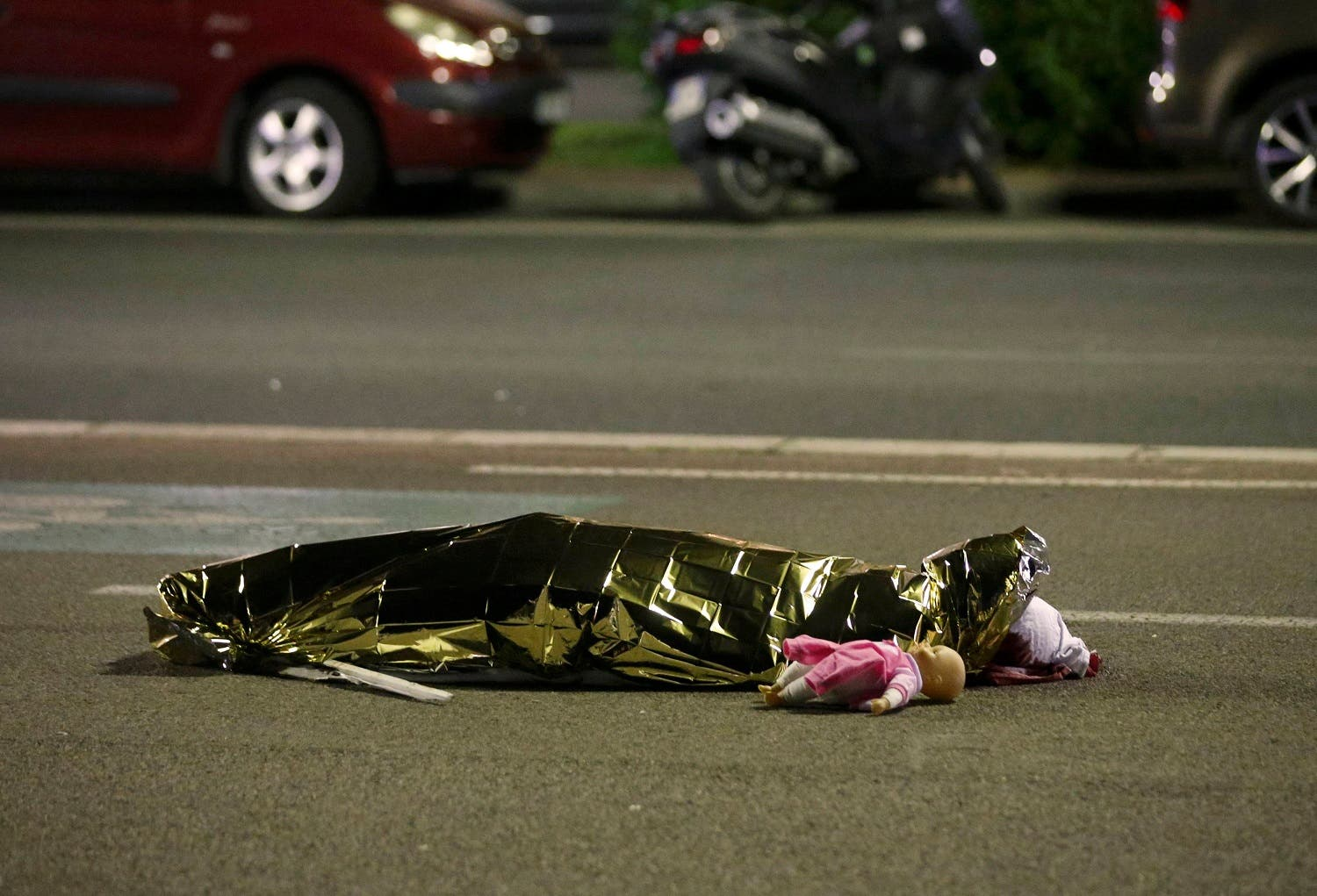 A body is seen on the ground after at least 30 people were killed in the southern French town of Nice when a truck ran into a crowd celebrating the Bastille Day national holiday. (Reuters)