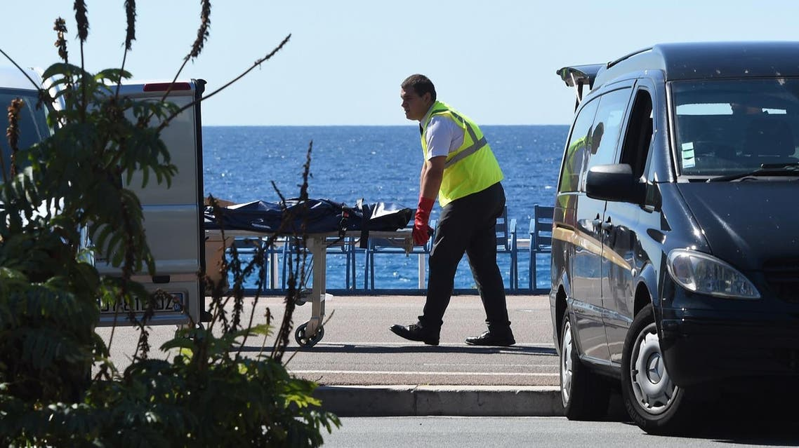 A forensic expert evacuates a dead body, unconfired if attacker or victim's, on the Promenade des Anglais seafront in the French Riviera city of Nice. (AFP)