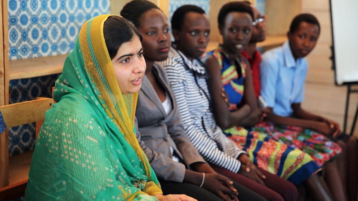 Pakistani Nobel Peace Prize laureate Malala Yousafzai talks to Burundian refugee girls at the Mahama refugee camp, Rwanda, July 14, 2016. Picture taken July 14, 2016. REUTERS/Katy Migiro?