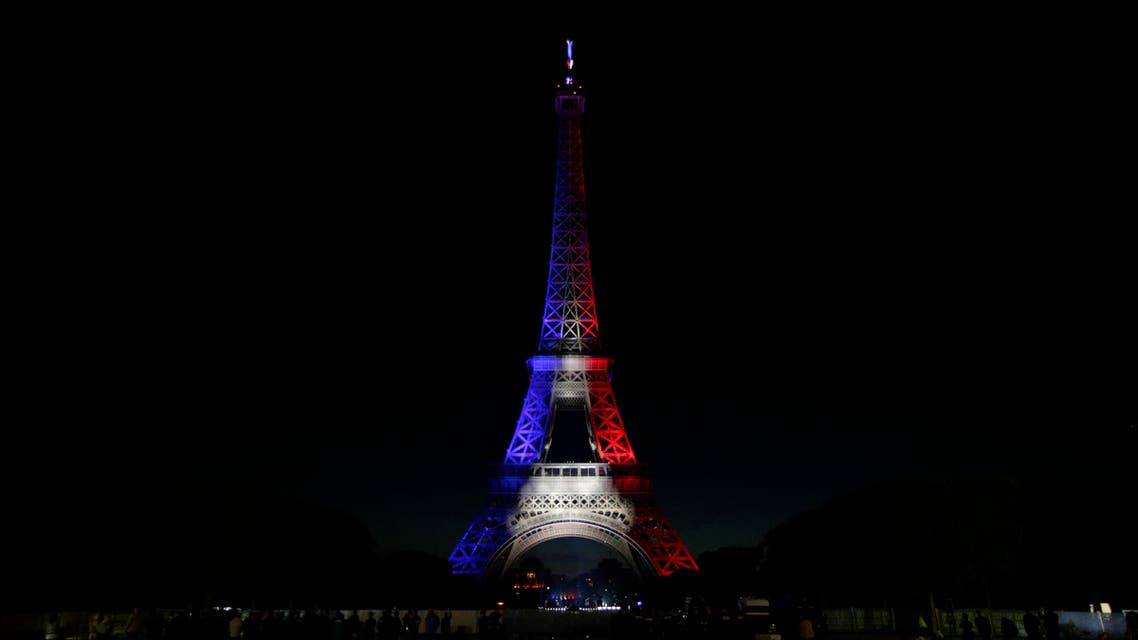 A picture taken on July 14, 2016 shows the Eiffel Tower illuminated with the colours of the French flag in the French capital Paris, as part of France's annual Bastille Day celebrations. AFP