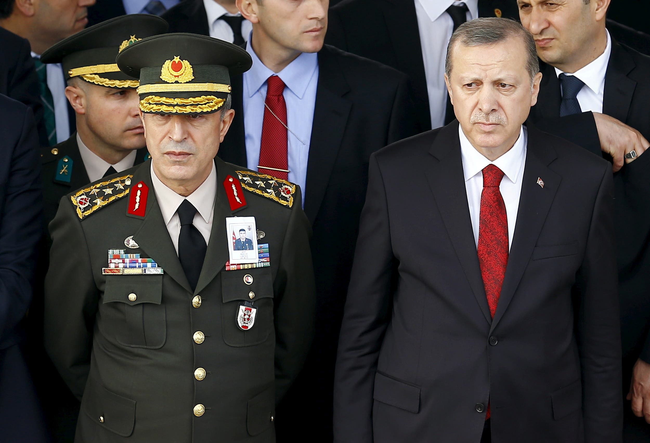 Turkish President Tayyip Erdogan (R) and Chief of Staff General Hulusi Akar attend a funeral ceremony for Army officer Seckin Cil in Ankara, Turkey, February 18, 2016. (Reuters)
