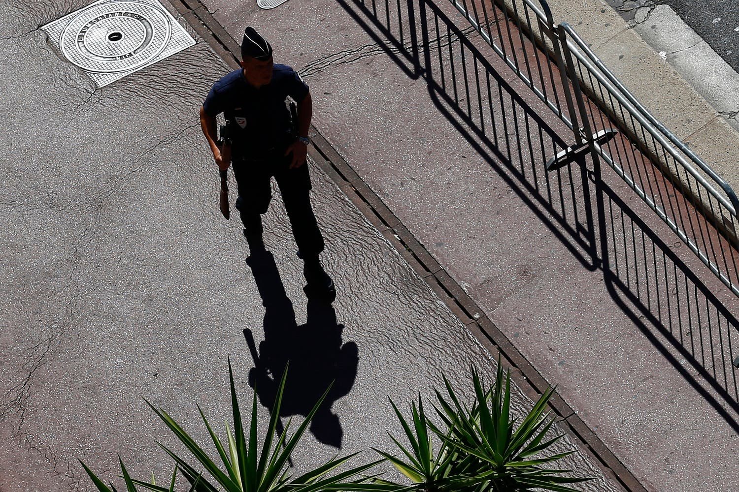 A police officer patrols at the scene where a truck mowed through revelers in Nice, southern France, Friday, July 15, 2016 (Photo: AP)