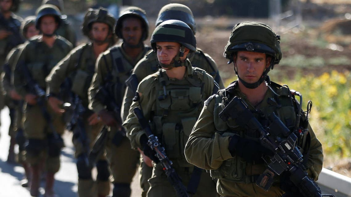 Israeli soldiers provide security during a protest against the killing of two settlers by Palestinians in two separate attacks, near the Jewish settlement of Otniel in the West Bank, July 10, 2016. (File Photo Reuters)