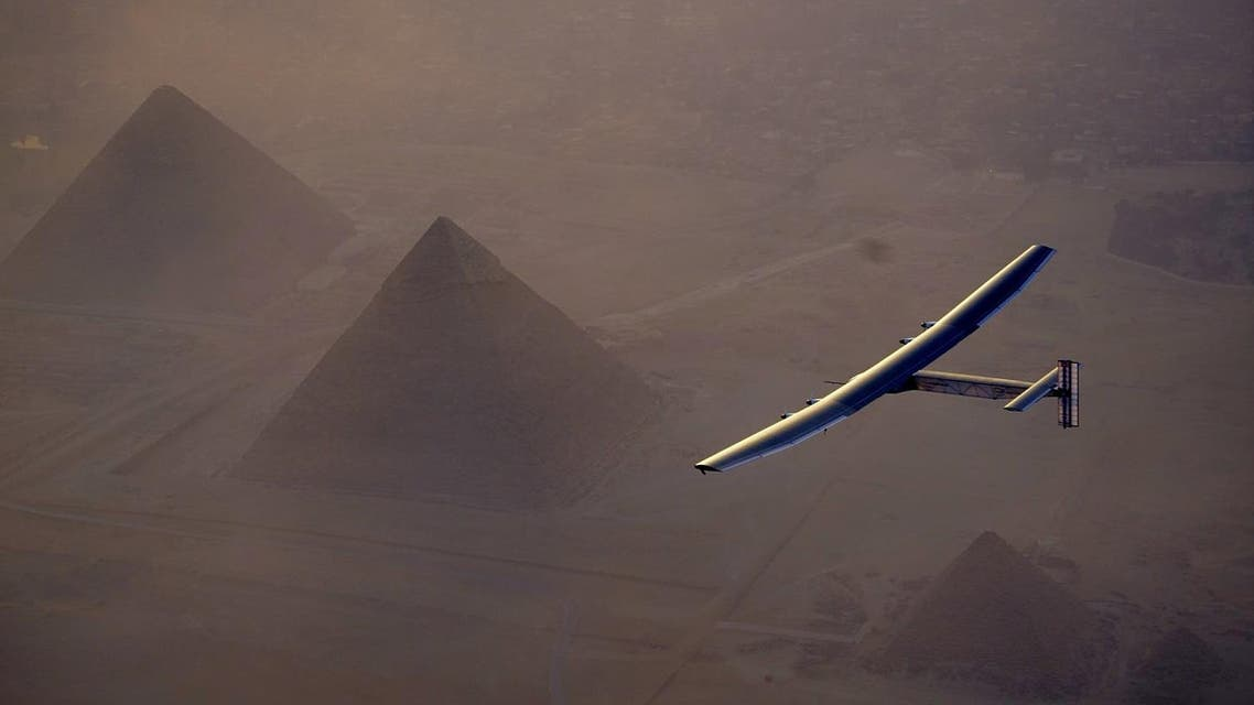 In this Wednesday, July 13, 2016, handout image provided by Solar Impulse, the Solar Impulse 2 flying over the pyramids, Egypt Cairo. The experimental solar-powered airplane has arrived in Egypt as part of its global voyage. (Jean Revillard, Rezo via the AP, File)