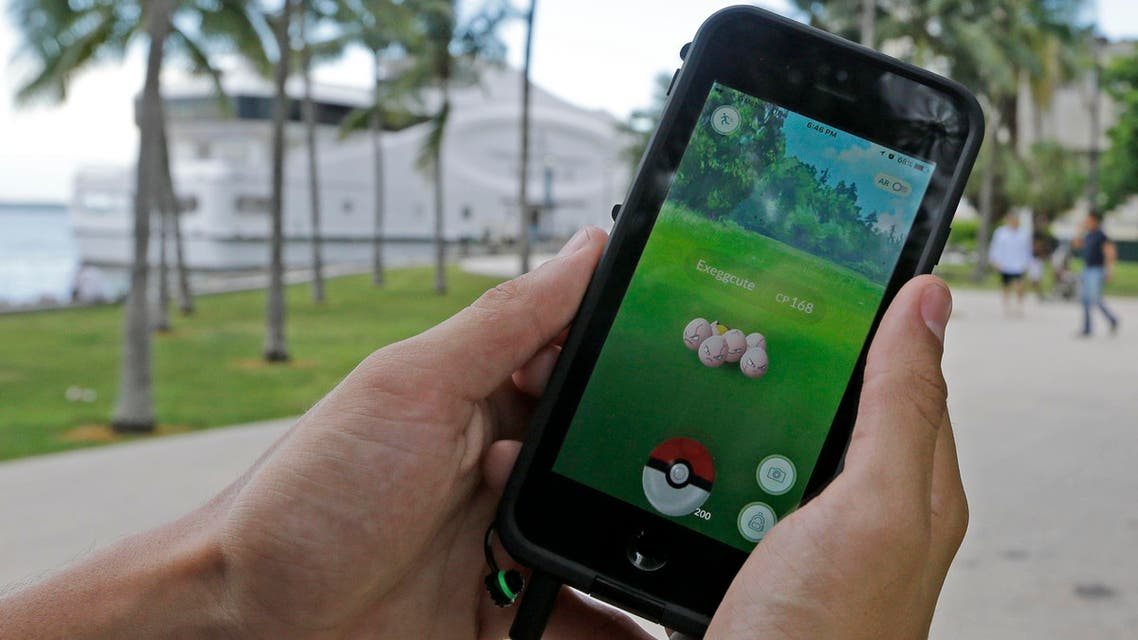 Exeggcute, a Pokemon, is found by a Pokemon Go player, Tuesday, July 12, 2016, at Bayfront Park in downtown Miami.