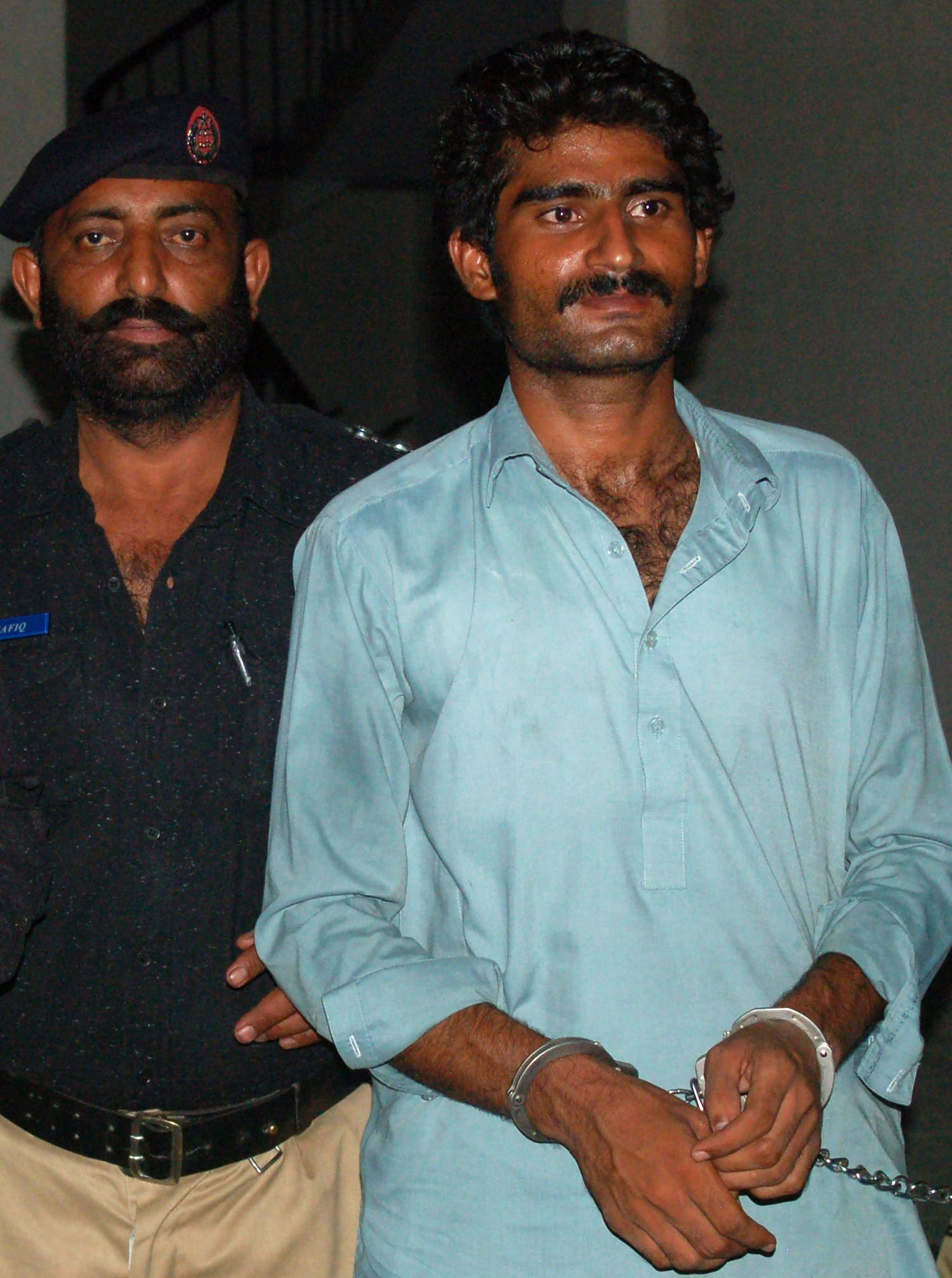 Wasim (R), the brother of slain social media celebrity Qandeel Baloch, is escorted by police following his arrest for Qandeel's death in Multan. (AFP)