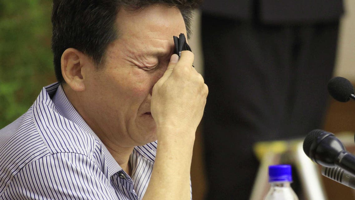 Ko Hyon Chol is overcome with emotion as he is presented to reporters in Pyongyang, North Korea, on Friday, July 15, 2016. (AP)