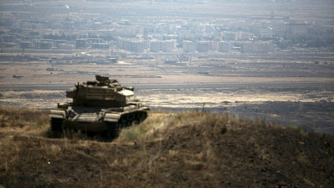 The Syrian area of Quneitra is seen in the background as an out-of-commission Israeli tank parks on a hill, near the ceasefire line between Israel and Syria, in the Israeli-occupied Golan Heights, August 21, 2015.(Reuters)