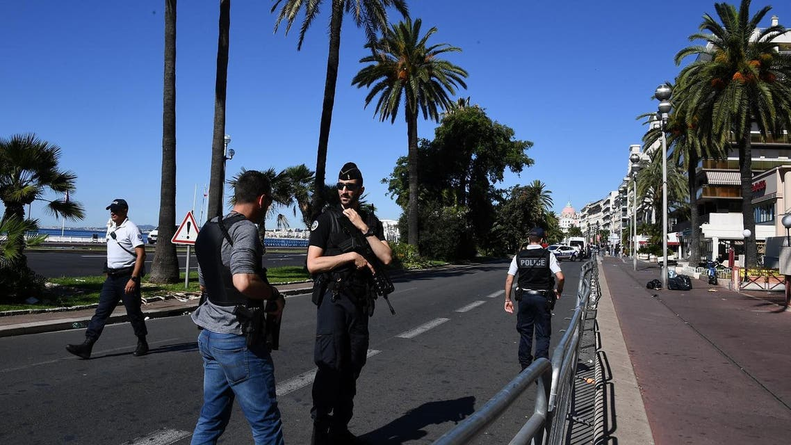Policemen stand guard the Promenade des Anglais seafront in the French Riviera town of Nice. (AFP)