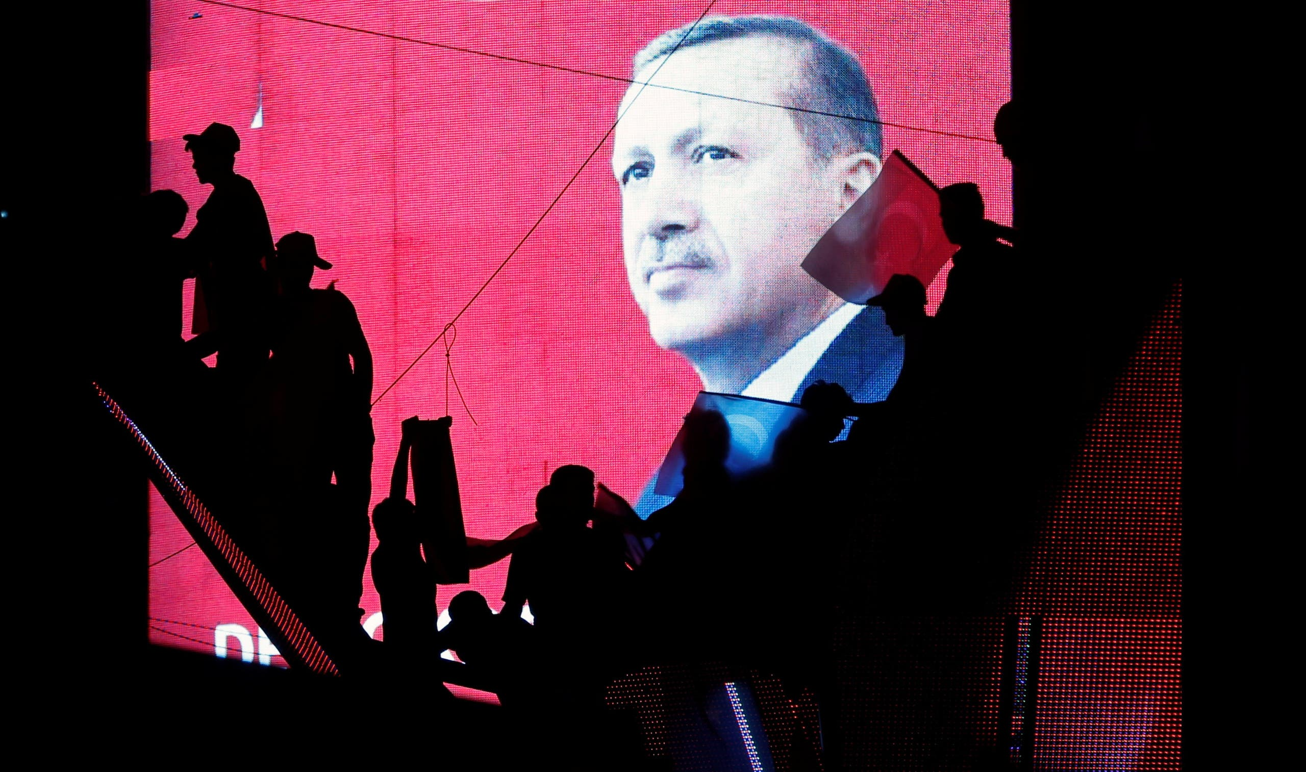 Turkish Supporters are silhouetted against a screan showing President Tayyip Erdogan during a pro-government demonstration in Ankara, Turkey, July 17, 2016. (Reuters)